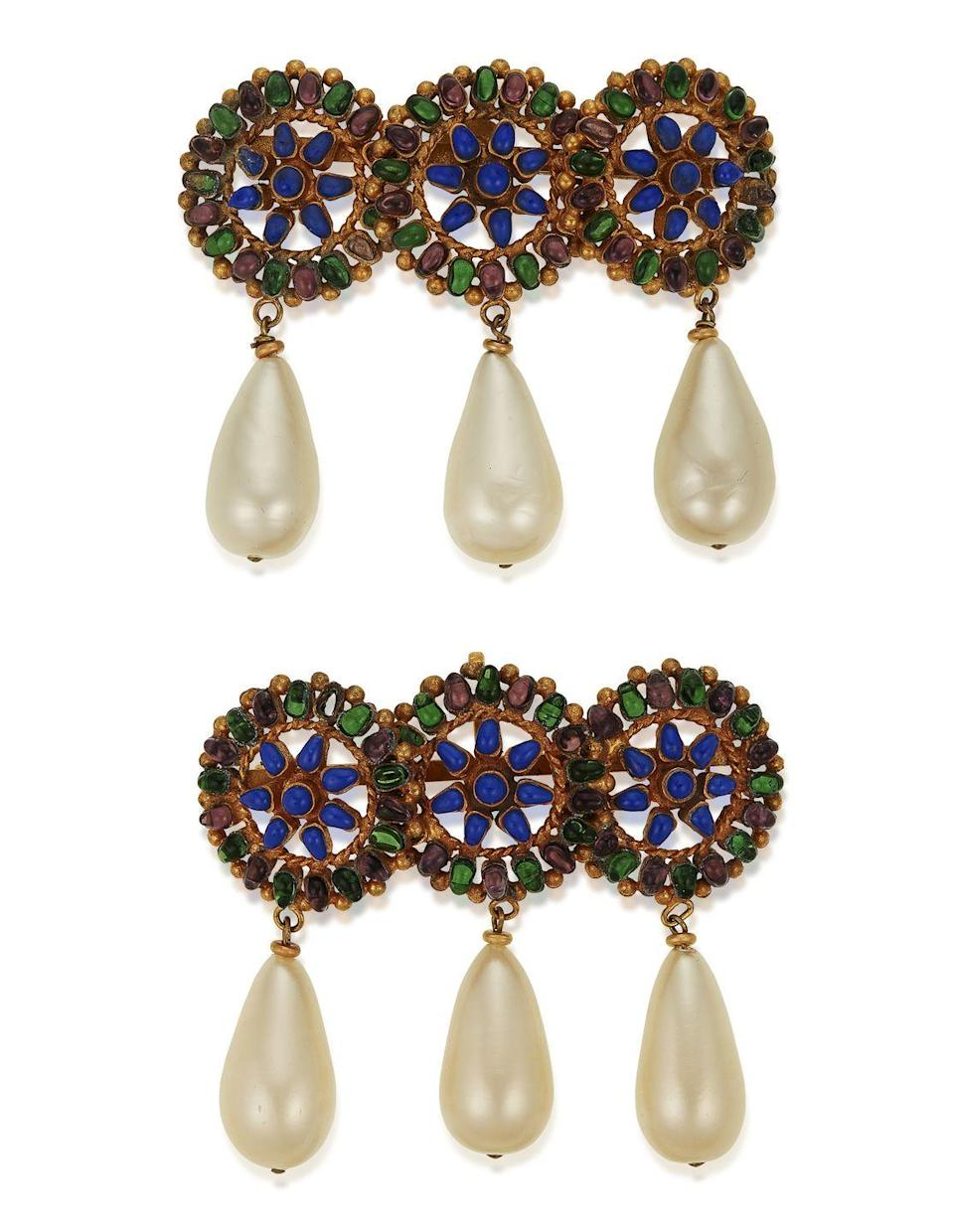 <p>Brooches are our favorite way to get Zoom-ready (besides having a craft cocktail nearby), and this beautiful pair is estimated to be worth $2,000 to $3,000. </p>