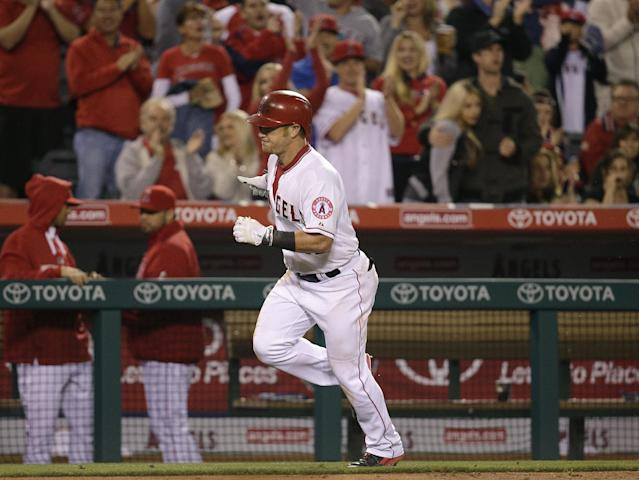 Los Angeles Angels' Kole Calhoun runs toward home plate after hitting a two-run home run during the fourth inning of a baseball game against the Oakland Athletics on Tuesday, April 15, 2014, in Anaheim, Calif. (AP Photo/Jae C. Hong)
