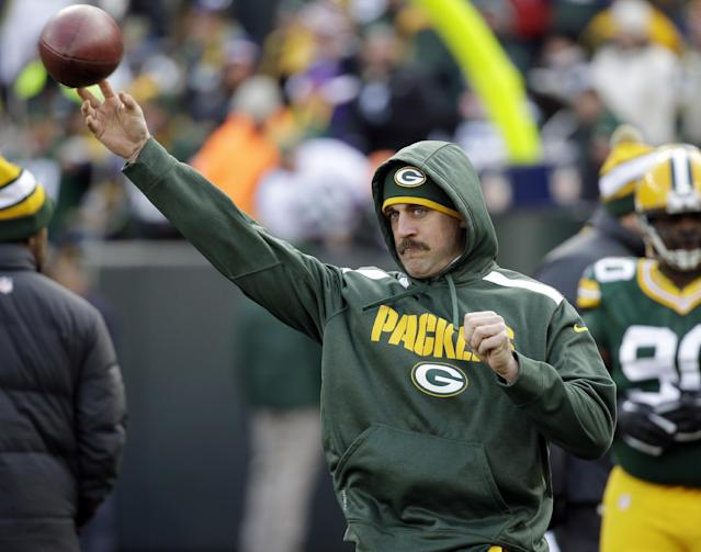 Green Bay Packers' Aaron Rodgers throws before an NFL football game against the Minnesota Vikings Sunday, Nov. 24, 2013, in Green Bay, Wis. (AP Photo/Mike Roemer)