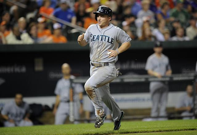 Seattle Mariners' Kyle Seager runs towards home to score on a single by Michael Morse during the fifth inning of a baseball game, Saturday, Aug. 3, 2013, in Baltimore. (AP Photo/Nick Wass)