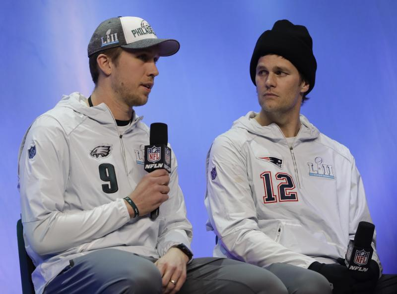 It's probably safe to say most of America is pulling for the guy on the left, Nick Foles. (AP)