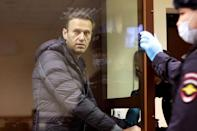 Alexei Navalny, jailed earlier in the week, attended court to face another charge of defamation