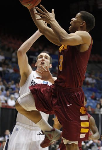 Iona guard Scott Machado (3) drives against Brigham Young forward Noah Hartsock in the second half of an NCAA men's college basketball tournament opening-round game, Tuesday, March 13, 2012, in Dayton, Ohio. (AP Photo/Skip Peterson)