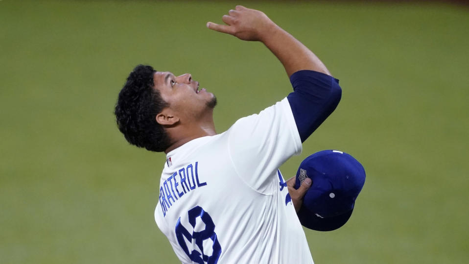 Los Angeles Dodgers relief pitcher Brusdar Graterol (48) celebrates after a catch by Cody Bellinger ending the top of the seventh inning in Game 2 of a baseball National League Division Series Wednesday, Oct. 7, 2020, in Arlington, Texas. (AP Photo/Tony Gutierrez)
