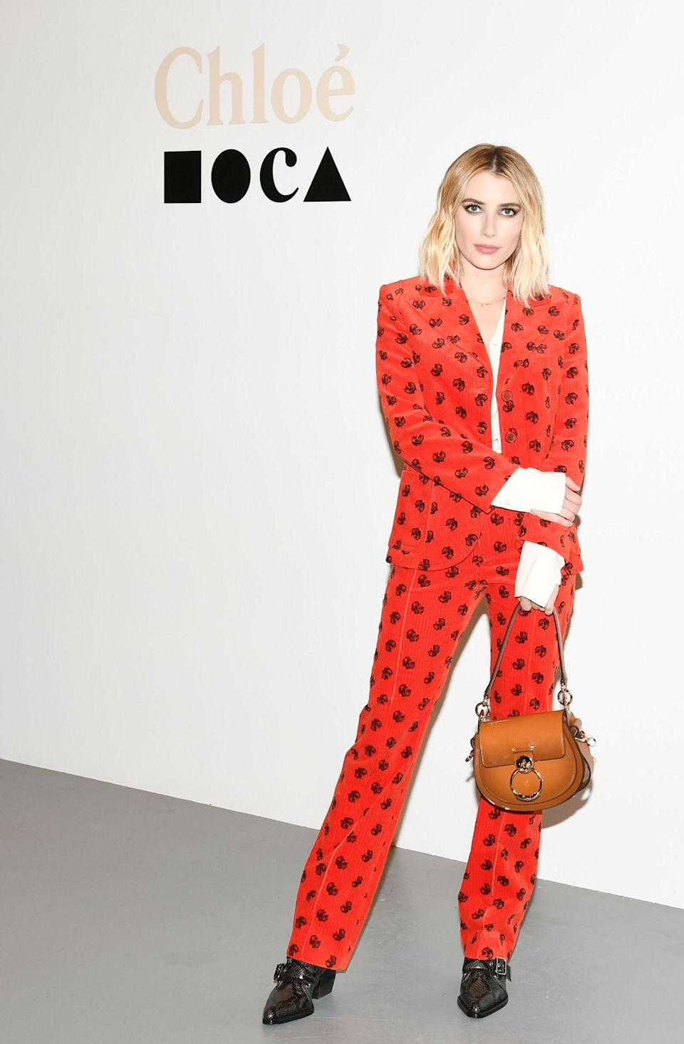 <p>On November 27, Emma Roberts gave us major suit envy in a Chloe two-piece finished with one of the label's seriously coveted bags. <em>[Photo: Rex]</em> </p>