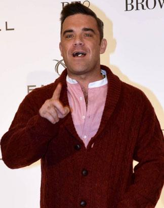 One Direction Invite Robbie Williams To Join Group