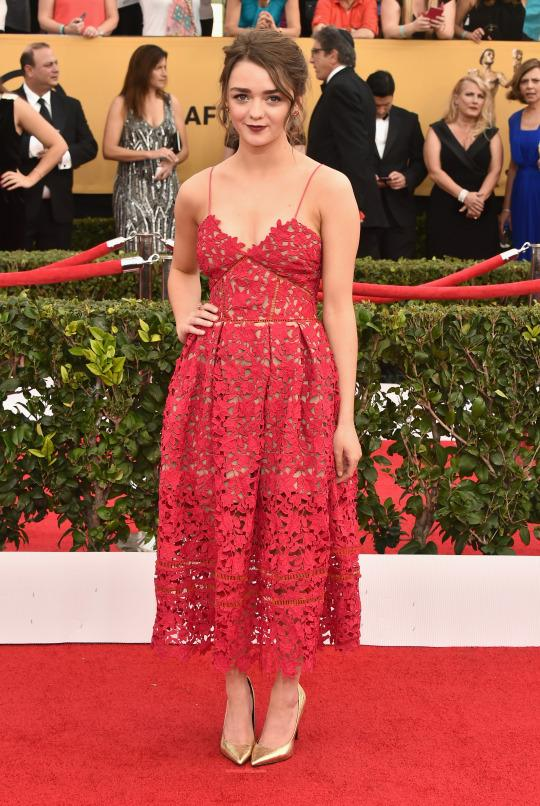 """<p>In January, Maisie Williams proved just how good an actress she is, putting as much distance between her own self and her """"Game of Thrones"""" character Arya Stark as possible, in this feminine red lace dress at the 21st Annual Screen Actors Guild Awards in LA.</p>"""