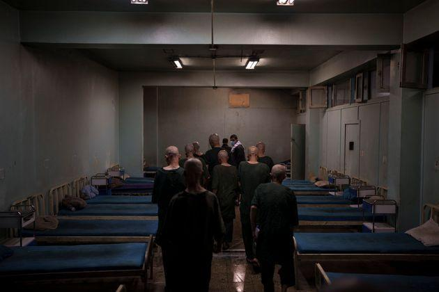 Drug users detained during a Taliban raid are taken to their room at the detoxification ward of the Avicenna Medical Hospital for Drug Treatment in Kabul, Afghanistan, Saturday, Oct. 2, 2021. (AP Photo/Felipe Dana) (Photo: via Associated Press)