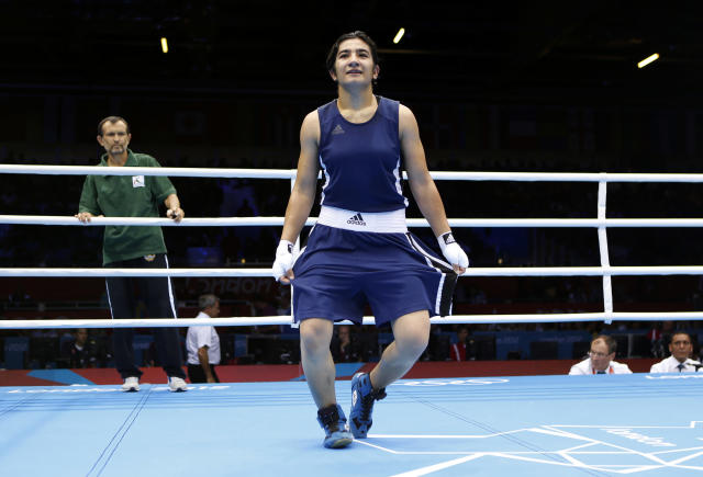 Tajikistan's Mavzuna Chorieva curtsies after winning her quarterfinal Women's Light (60kg) boxing match against China's Dong Cheng at the London Olympic Games August 6, 2012. REUTERS/Murad Sezer (BRITAIN - Tags: SPORT BOXING OLYMPICS)