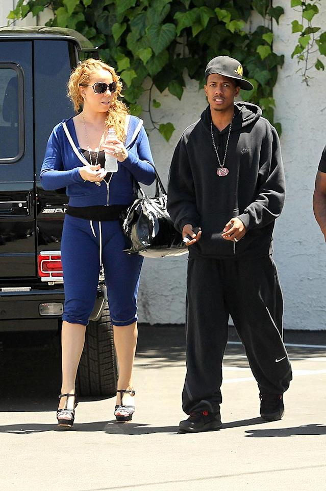 "We're all for sporting comfy clothing, but Mariah Carey and Nick Cannon looked downright ridiculous while running errands in their equally atrocious sweatsuits. Fashion-challenged Mimi paired her royal blue blunder with t-strap peep-toe pumps, and her hubby's oversized gear made him look even more minuscule than he already is. Nathanael Jones/Sam Sharma/<a href=""http://www.pacificcoastnews.com/"" target=""new"">PacificCoastNews.com</a> - May 11, 2010"