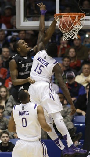 LIU Brooklyn forward Jamal Olasewere (1) dunks against James Madison guard Andre Nation (15) in the second half of a first-round game of the NCAA college basketball tournament on Wednesday, March 20, 2013, in Dayton, Ohio. (AP Photo/Al Behrman)