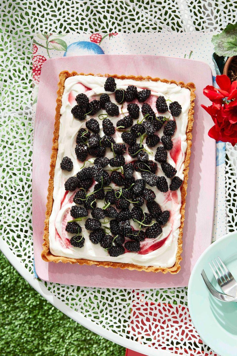 """<p>A rich blackberry mascarpone filling makes this tart irresistible, especially alongside your other delicious brunch treats.</p><p><strong><a href=""""https://www.countryliving.com/food-drinks/a28609911/blackberry-tart-recipe/"""" rel=""""nofollow noopener"""" target=""""_blank"""" data-ylk=""""slk:Get the recipe"""" class=""""link rapid-noclick-resp"""">Get the recipe</a>.</strong> </p>"""
