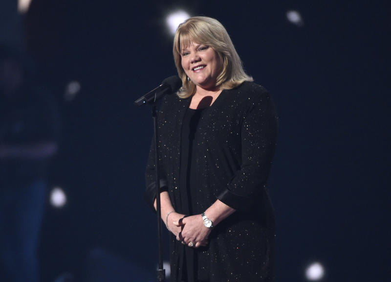 "FILE - This April 19, 2015 file photo shows Andrea Finlay, mother of Taylor Swift, presenting the milestone award to her daughter at the 50th annual Academy of Country Music Awards in Arlington, Texas.  Swift has revealed in a new interview that her mother has a brain tumor. Swift, who has spoken about her mother's battle with cancer over the years, told Variety in an interview published Tuesday, Jan. 21, 2020, that while her mother was going through treatment, ""they found a brain tumor.""(Photo by Chris Pizzello/Invision/AP, File)"