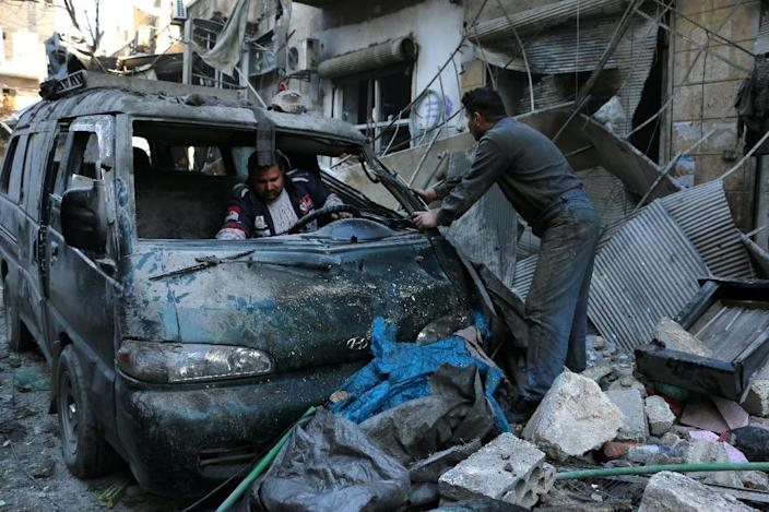 A damaged vehicle under rubble following a reported air strike by Syrian government forces on Aleppo's Sukkari on January 16, 2016 (AFP Photo/Karam Al-Masri)