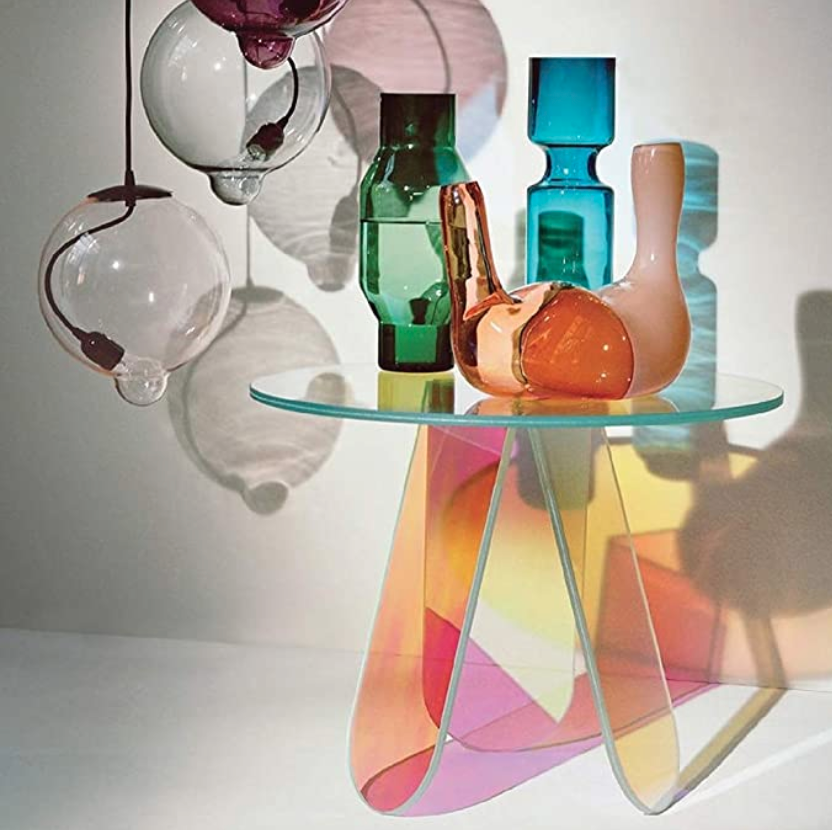 """<h3>Acrylic Iridescent End Table</h3><br>Although a bit of a splurge, this statement-making rainbow side table is a true amazon hidden home gem. <br><br><strong>Homary</strong> Acrylic Iridescent End Table, $, available at <a href=""""https://amzn.to/3D3j5sT"""" rel=""""nofollow noopener"""" target=""""_blank"""" data-ylk=""""slk:Amazon"""" class=""""link rapid-noclick-resp"""">Amazon</a>"""