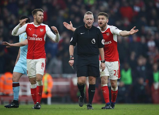 <p>Mustafi rages at Jon Moss after the decision to give the Clarets a penalty in the 90th minute. </p>