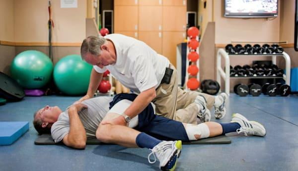 """<b class=""""credit"""">Getty Images</b>Physical therapist working with a patient."""