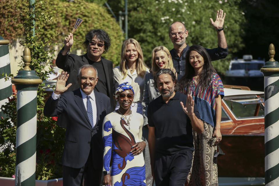 FILE - In this Sept, 1, 2021 file photo Jury President Bong Joon Ho, from top left, Jury members Virginie Efira, Sarah Gadon, Alexander Nanau, director of the Venice Film festival Alberto Barbera, from bottom left, jury members Cynthia Erivo, Saverio Costanzo and Chloe Zhao pose for photographers upon arrival at the 78th edition of the Venice Film Festival in Venice, Italy. (Photo by Joel C Ryan/Invision/AP, File)