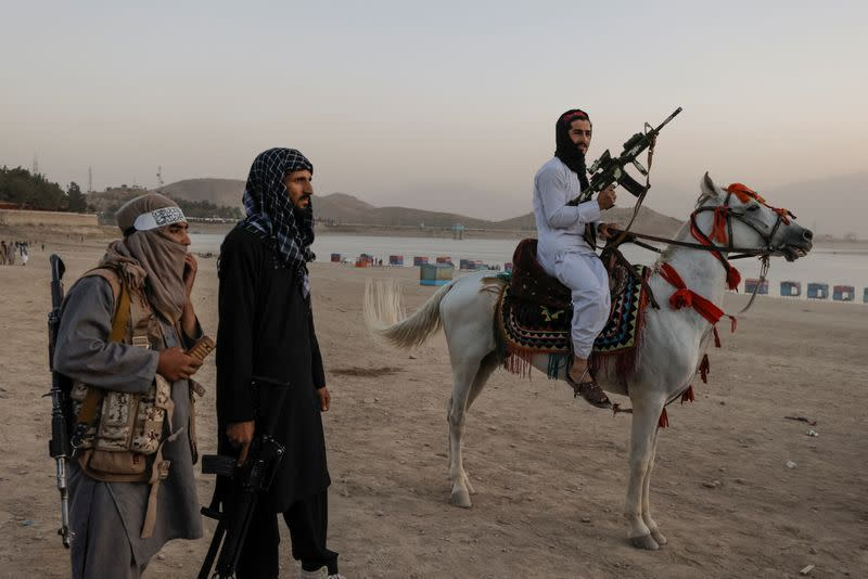 Taliban fighters flock to Kabul recreation spot for a day off