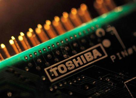 Toshiba Corp is seen on a printed circuit board in this