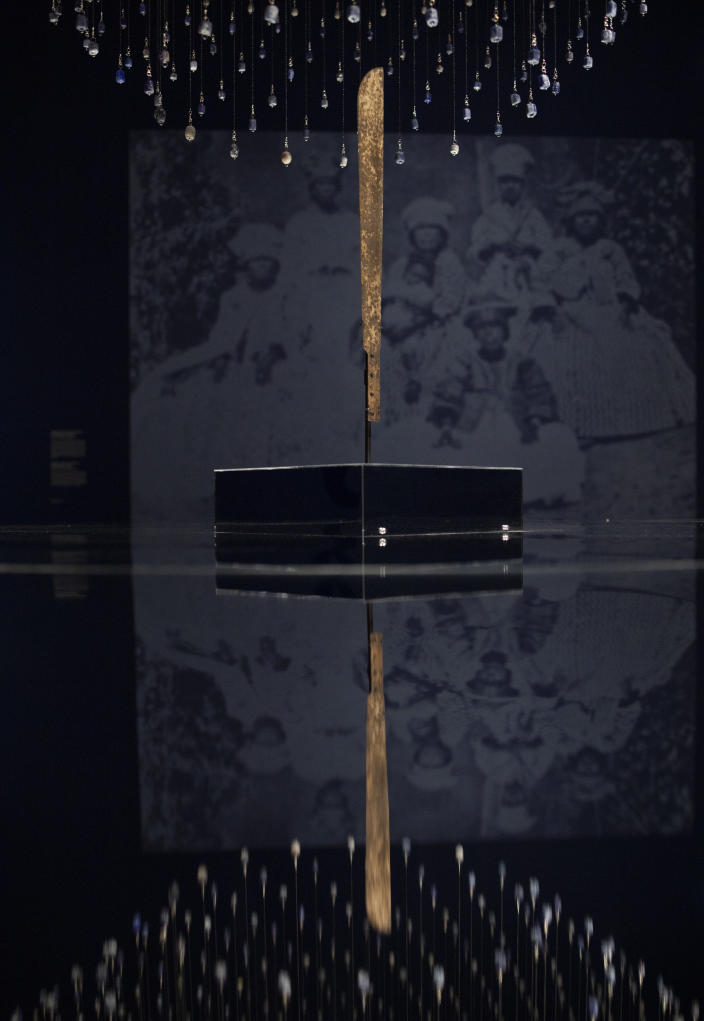 """A machete used for cutting sugar cane is displayed at the Slavery exhibition Rijksmuseum in Amsterdam, Netherlands, Monday, May 17, 2021. The stark contrast between finery and brutality, wealth and inhumanity is a recurring pattern at the museum's unflinching new exhibition titled, simply, """"Slavery"""", that examines the history of Dutch involvement in the international slave trade. (AP Photo/Peter Dejong)"""