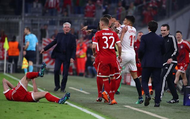 """A goalless draw against Sevilla on Wednesday night was enough to send Bayern Munich into the Champions League last four with a 2-1 aggregate victory to keep their hopes of a treble-winning season alive. Bayern, playing in their seventh straight Champions League quarter-final, never needed to hit top form but were in control throughout with the largely toothless Spaniards only rarely venturing into their opponents' box. The Germans, who last won the treble in 2013, again under coach Jupp Heynckes, had secured a 2-1 advantage from last week's first leg and advanced after having been eliminated by a Spanish team in each of the past four seasons. Sevilla ended the game with 10 men after the dismissal in stoppage time of Joaquin Correa for a rough challenge on Javi Martinez. The result, however, meant Sevilla, in the last eight of the European Cup for the first time since their only previous appearance at this stage 60 years ago, still managed to snap Heynckes' 12-game record winning run in the competition. """"Sevilla have a good team and they proved it,"""" Bayern winger Arjen Robben said. """"But we had enough chances and we should have scored. Defensively everything has to work in the Champions League and it did for us tonight. """"In the Champions League you always have to bring your top performance and we will need to improve, that's clear."""" In a physical first half, Bayern, fresh from securing the Bundesliga title last weekend, were by far the more dangerous team with Robert Lewandowski and Franck Ribery coming close. Poland forward Lewandowski, who was sporting a swollen eye after some robust defending, also narrowly headed wide four minutes after the restart. Sevilla at times looked to be lacking a sense of urgency and were badly let down by their final pass, stumbling time and again at the edge of the box and failing to get a shot on target in the entire first half. """"We are a bit upset,"""" said Sevilla captain Sergio Escudero. """"We came here, tried, believed in the comeback b"""