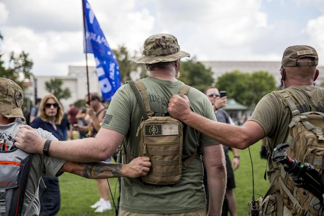 "<p>Militia members hold each others backpacks during a pro-Trump ""Mother of all Rallies"" (MOAR) event on the National Mall in Washington on Saturday, Sept. 16, 2017. MOAR, the ""Woodstock of American Rallies,"" wants to send a message to Congress, the media and the world that the attendees stand to defend American values and culture. (Photo: Alex Wroblewski/Bloomberg via Getty Images) </p>"