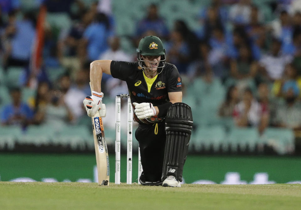 Australia's Steven Smith reacts after playing a shot during the second T20 international cricket match between Australia and India at the Sydney Cricket Ground in Sydney, Australia, Sunday, Dec. 6, 2020. (AP Photo/Rick Rycroft)