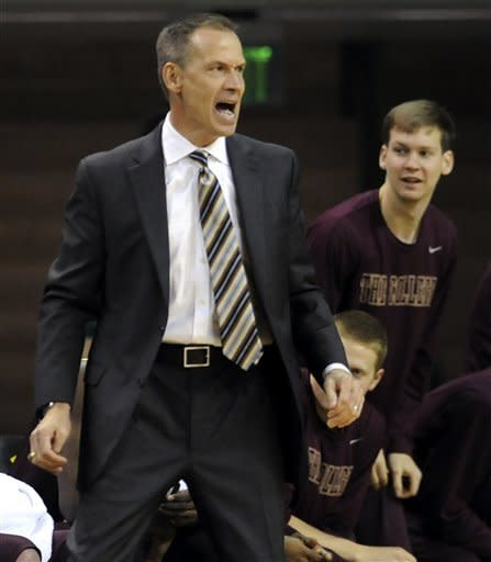 College of Charleston head coach Doug Wojcik reacts to a play against Baylor in the first half of an NCAA college basketball game, Saturday Nov. 24, 2012, in Waco, Texas. (AP Photo/Waco Tribune Herald, Rod Aydelotte)