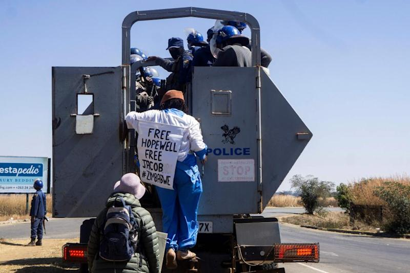 Zimbabwean novelist Tsitsi Dangarembga (centre) and a colleague, Julie Barnes, being are arrested during an anti-corruption protest march in Harare, 31 July 2020.