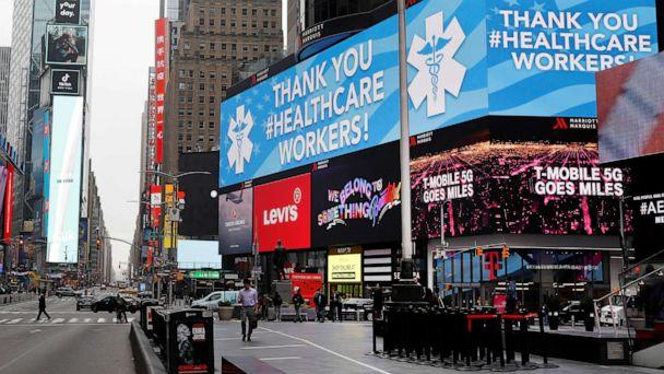 PHOTO: A message thanking healthcare workers during the coronavirus outbreak is seen on an electronic billboard in a nearly empty Times Square in Manhattan in New York, March 20, 2020. (Mike Segar/Reuters)