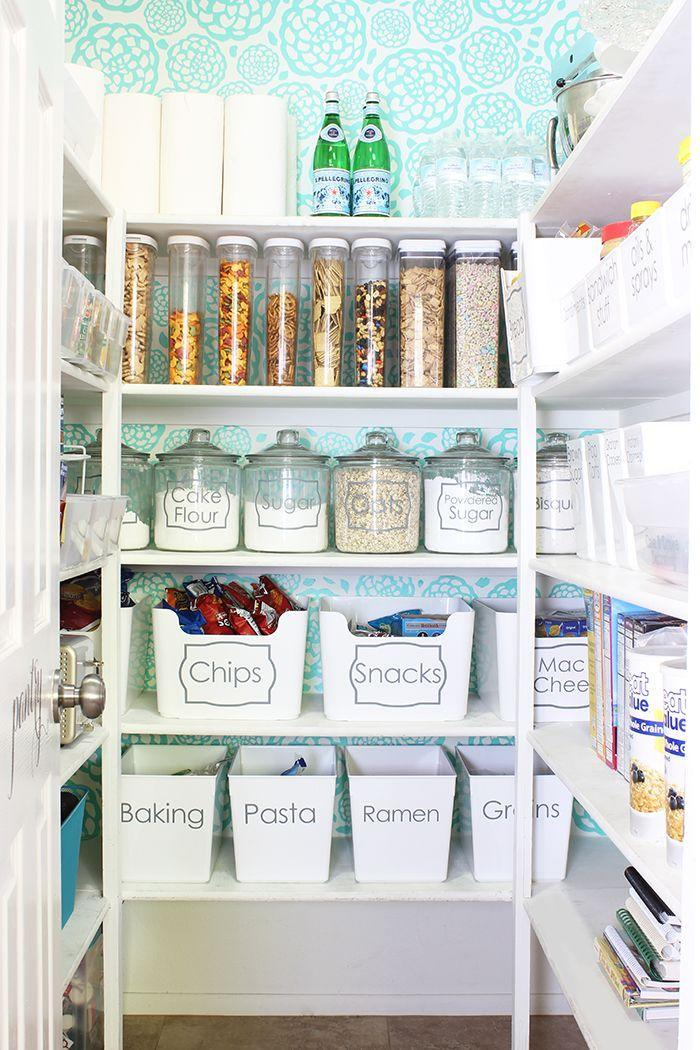 """<p>Mint-colored wall decals gave this room a fresh and clean look instantly. This blogger also added clear food containers to make it easier for her to eyeball items she's running low on before heading out to the store.</p><p><em><a href=""""http://www.classyclutter.net/2015/10/how-to-organize-your-pantry/"""" rel=""""nofollow noopener"""" target=""""_blank"""" data-ylk=""""slk:See more at Classy Clutter »"""" class=""""link rapid-noclick-resp"""">See more at Classy Clutter »</a></em></p><p><strong>What you'll need:</strong> wallpaper, $6 per square foot,<span class=""""redactor-invisible-space""""> <a href=""""https://www.wayfair.com/Walls-Need-Love-Turquoise-Spirals-Removable-5-x-20-Abstract-Wallpaper-WANL2839.html"""" rel=""""nofollow noopener"""" target=""""_blank"""" data-ylk=""""slk:wayfair.com"""" class=""""link rapid-noclick-resp"""">wayfair.com</a></span><br></p>"""