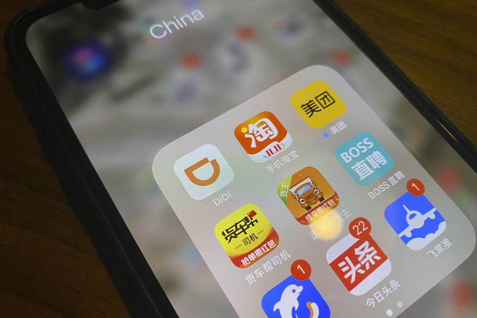 The ride-hailing app Didi is seen near other Chinese apps on a phone in Beijing on Monday, July 5, 2021. Chinese regulators have clamped down on the country's largest ride-hailing app, Didi Global Inc., days after its shares began trading in New York. Authorities told Didi to stop new registrations and ordered its app removed from China's app stores pending a cybersecurity review. (AP Photo/Ng Han Guan)
