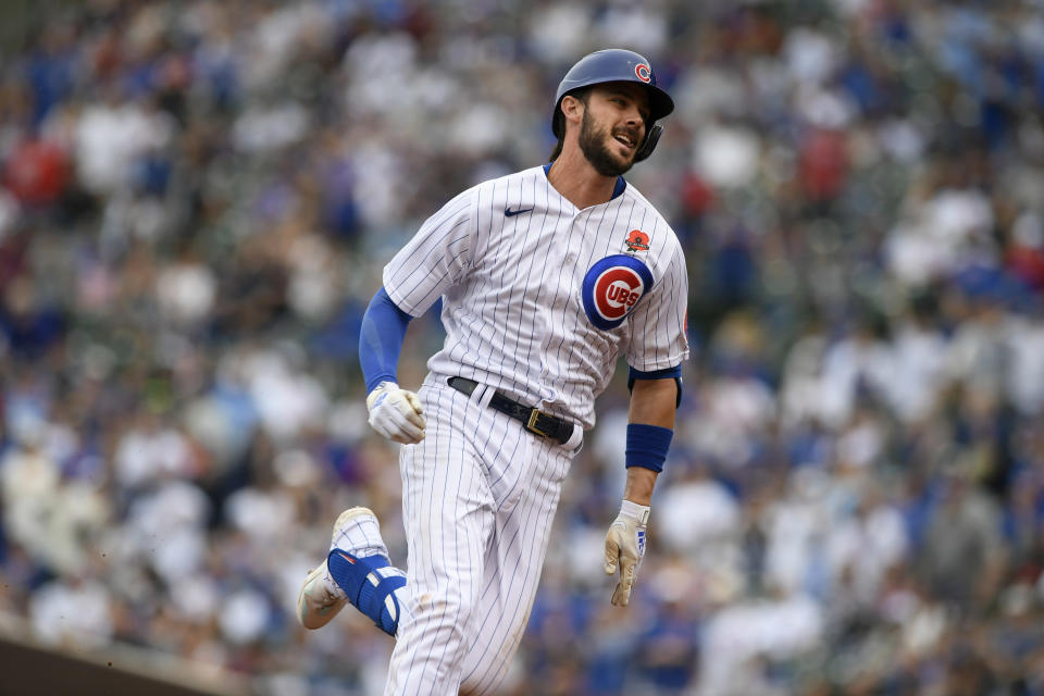 FILE - Chicago Cubs' Kris Bryant runs to third base on his triple during the third inning of a baseball game against the San Diego Padres in Chicago, in this May 31, 2021, file photo. Bryant's versatility, while producing offensive numbers that belong alongside his NL MVP season in 2016, is a big reason why Chicago is on top of the NL Central once again, helping the Cubs go on a 21-9 run while dealing with a rash of injuries. (AP Photo/Paul Beaty, File)