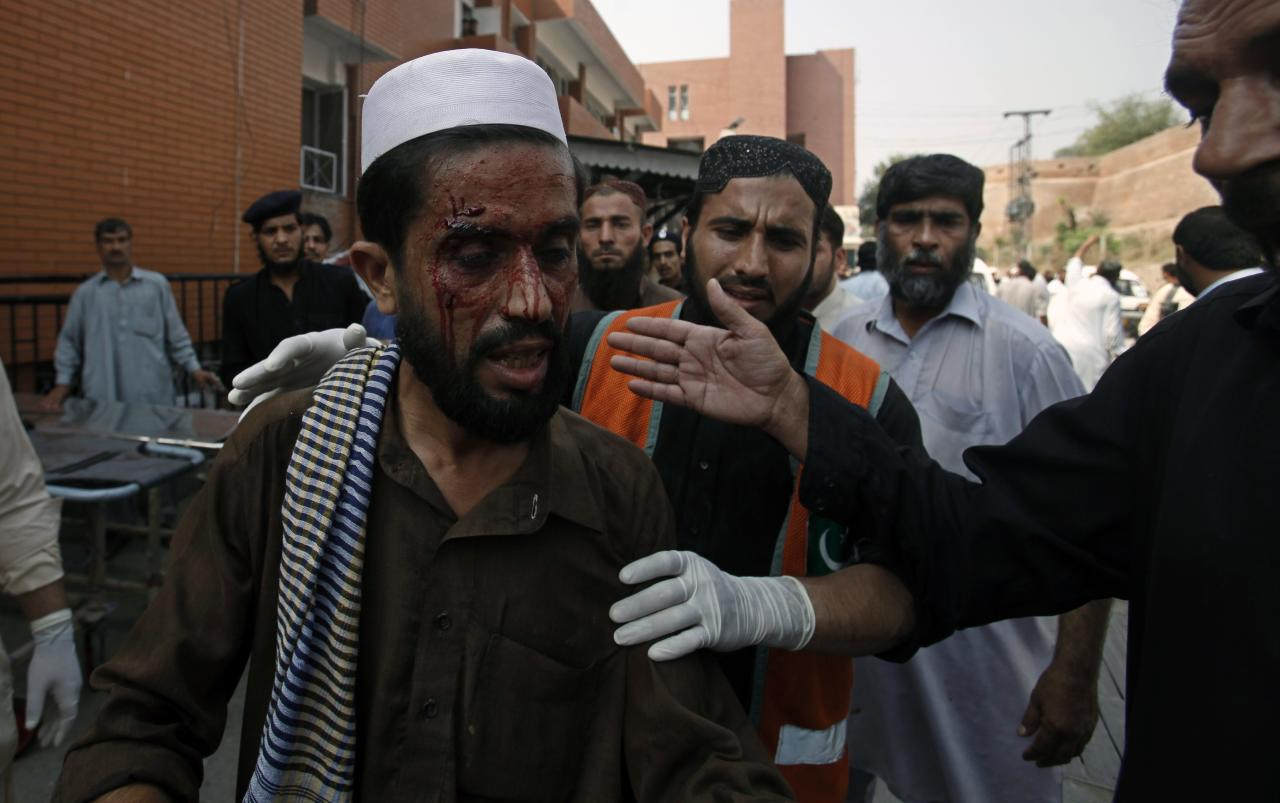 ATTENTION EDITORS - VISUAL COVERAGE OF SCENES OF INJURY OR DEATH  A man who was injured during a bomb blast arrives at a hospital in Peshawar September 29, 2013. Twin blasts in the northwestern Pakistan city of Peshawar killed 33 people and wounded 70 on Sunday, a week after two bombings at a church in the frontier city killed scores, police and hospital authorities said.REUTERS/ Fayaz Aziz (PAKISTAN - Tags: POLITICS CIVIL UNREST CRIME LAW)