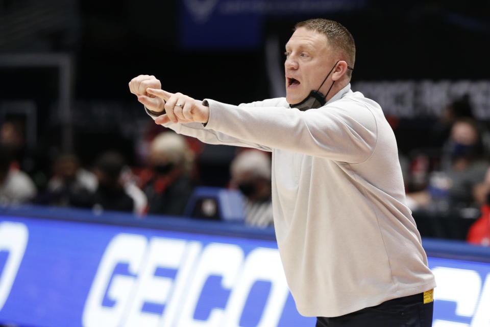 VCU head coach Mike Rhoades shouts to his team against St. Bonaventure during the first half of an NCAA college basketball game for the Atlantic Ten Conference championship Sunday, March 14, 2021, in Dayton, Ohio. (AP Photo/Jay LaPrete)