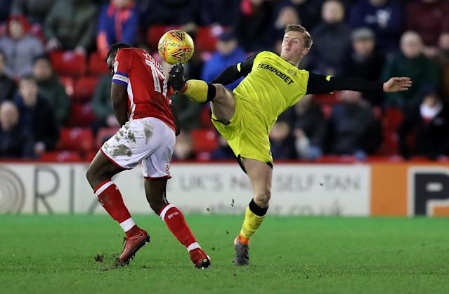 "Soccer Football - Championship - Barnsley vs Burton Albion - Oakwell, Barnsley, Britain - February 20, 2018 Burton Albion's Jamie Allen in action with Barnsley's Andy Yiadom Action Images/John Clifton EDITORIAL USE ONLY. No use with unauthorized audio, video, data, fixture lists, club/league logos or ""live"" services. Online in-match use limited to 75 images, no video emulation. No use in betting, games or single club/league/player publications. Please contact your account representative for further details."