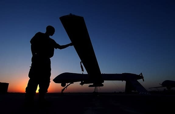 A crew chief from the 46th Expeditionary Reconnaissance Squadron completes post flight inspections of an RQ-1 Predator on Sept. 15, 2004, at Balad Air Base in Iraq.