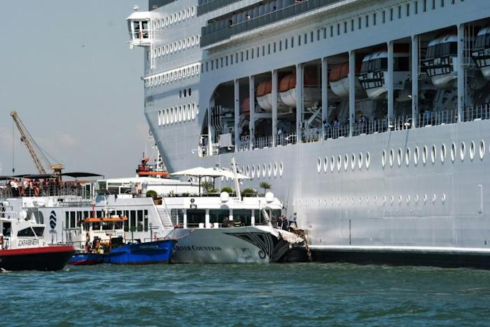Rescue boats assist the damaged River Countess tourist boat after it was hit early on June 2, 2019 by the MSC Opera cruise ship that lost control as it was coming in to dock in Venice, Italy (AFP Photo/Andrea PATTARO)