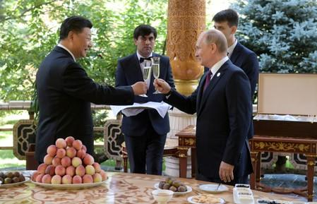 Russian President Vladimir Putin meets with Chinese President Xi Jinping before CICA summit in Dushanbe