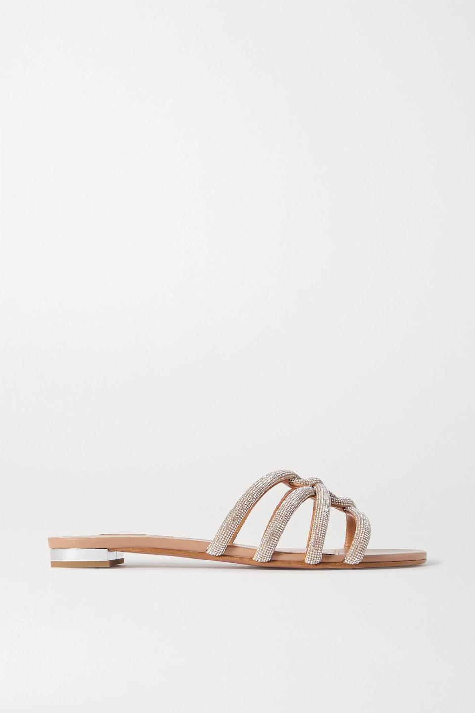"""<p><strong>Aquazzura</strong></p><p>net-a-porter.com</p><p><strong>$895.00</strong></p><p><a href=""""https://go.redirectingat.com?id=74968X1596630&url=https%3A%2F%2Fwww.net-a-porter.com%2Fen-us%2Fshop%2Fproduct%2Faquazzura%2Fmoondust-crystal-embellished-leather-slides%2F1230198&sref=https%3A%2F%2Fwww.harpersbazaar.com%2Fwedding%2Fbridal-fashion%2Fg36113322%2Fwedding-flats-for-brides%2F"""" rel=""""nofollow noopener"""" target=""""_blank"""" data-ylk=""""slk:SHOP NOW"""" class=""""link rapid-noclick-resp"""">SHOP NOW</a></p><p>For rehearsal dinners and brunches that don't require formality but need to feel a bit more dressed up, opt for an easy slide with a bit of sparkle.</p>"""