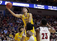 <p>Minnesota's Gabe Kalscheur (22) goes for a layup as Louisville's Steven Enoch (23) watches, during the second half of a first round men's college basketball game in the NCAA Tournament, in Des Moines, Iowa, Thursday, March 21, 2019. (AP Photo/Nati Harnik) </p>