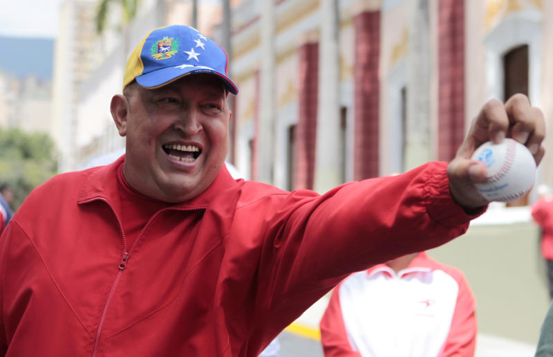 File - In this Thursday Sept. 29, 2011 file photo released by Miraflores Press Office, Venezuela's President Hugo Chavez holds out a baseball outside the presidential palace in Caracas, Venezuela. Throughout his presidency, Chavez has relied on his vigor and endurance: playing baseball and speaking for hours at a stretch. Now Chavez finds himself ailing as he heads into a re-election campaign against Henrique Capriles, a 39-year-old state governor who represents a younger and more energetic option, said Diego Moya-Ocampos, an analyst with the London-based consulting firm IHS Global Insight. (AP Photo/Miraflores Press Office, File)