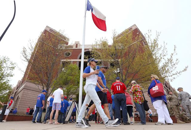Fans had trouble getting into Globe Life Park on opening day. (AP Photo/Richard W. Rodriguez)