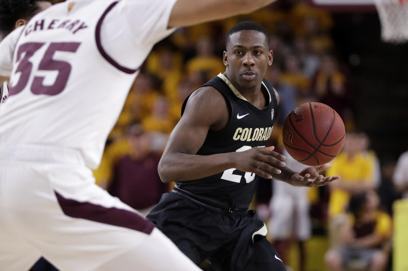 Colorado guard McKinley Wright IV looks to pass against Arizona State during the first half of an NCAA college basketball game, Thursday, Jan. 16, 2020, in Tempe, Ariz. (AP Photo/Matt York)