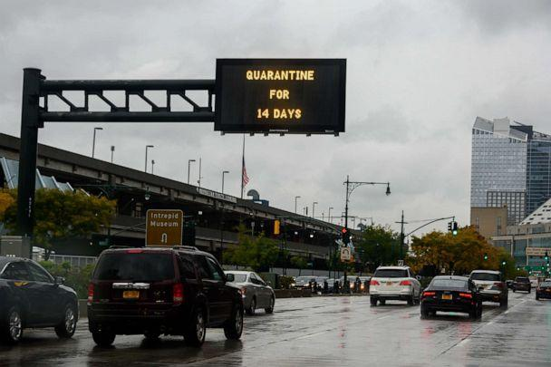 PHOTO: A traffic sign reads, 'quarantine for 14 days' above the West Side Highway as the city continues the re-opening efforts following restrictions imposed to slow the spread of coronavirus in New York, Nov. 01, 2020. (Noam Galai/Getty Images, FILE)