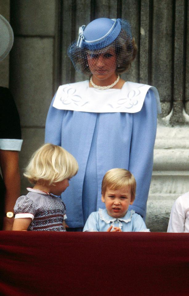 <p>Back in 1984, Princess Diana donned a powder blue smock dress accessorised with a veiled hat for the annual Trooping the Colour. [Photo: Rex] </p>