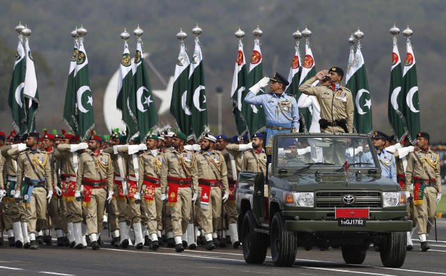 Pakistani troops march during a military parade to mark Pakistan National Day, in Islamabad, Pakistan, Saturday, March 23, 2019. Pakistanis are celebrating their National Day with a military parade that's showcasing short- and long-range missiles, tanks, jets, drones and other hardware. (AP Photo/Anjum Naveed)