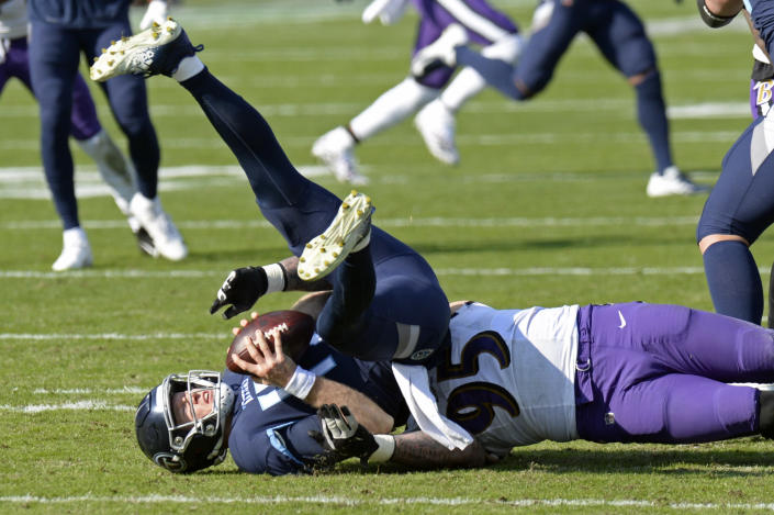 Tennessee Titans quarterback Ryan Tannehill (17) is sacked by Baltimore Ravens defensive end Derek Wolfe (95) for a 7-yard loss in the first half of an NFL wild-card playoff football game Sunday, Jan. 10, 2021, in Nashville, Tenn. (AP Photo/Mark Zaleski)