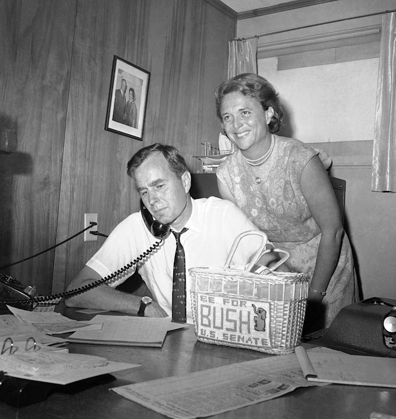 In this June 6, 1964, file photo George H.W. Bush, candidate for the Republican nomination for the U.S. Senate, gets returns by phone at his headquarters in Houston, as his wife Barbara, smiles at the news. Bush died at the age of 94 on Friday, Nov. 30, 2018, about eight months after the death of his wife, Barbara Bush. (AP Photo/Ed Kolenovsky, File) (ASSOCIATED PRESS)